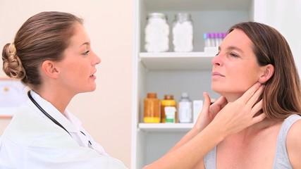 Nurse examining a patient