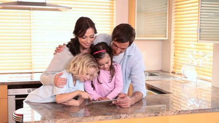 Family looking at a tablet pc