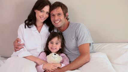 Smiling family embracing