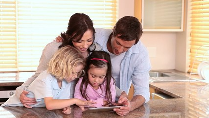 Family standing while using a tablet pc