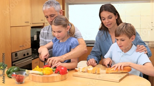 Smiling family preparing a meal