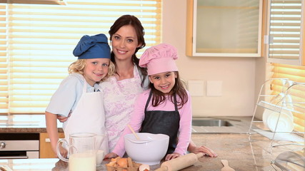 Smiling mother cooking with her children