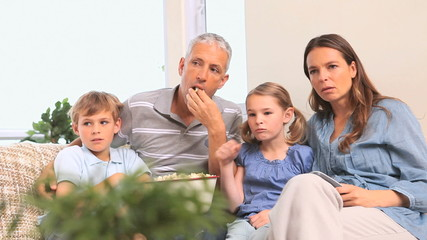 Family eating popcorn