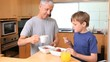 Father and son eating their breakfast together