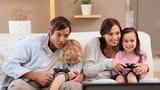 Happy siblings playing video games
