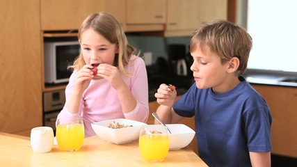 Cute siblings eating their breakfast