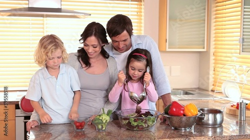 Smiling children cooking with their parents
