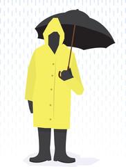 Man standing in raincoat in the rain.