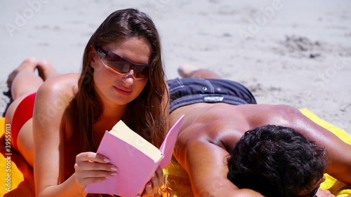 Relaxed brunette reading a book
