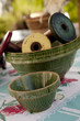 Vintage ceramic mixing bowls with wooden spools