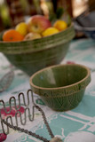 Vintage bowls, potato masher, and citrus fruits