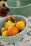 Fresh citrus fruits in a vintage ceramic bowl