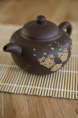 Small Asian ceramic teaot with cherry blossom motif