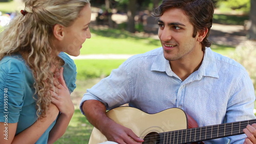 Boyfriend plays the guitar for his girlfriend