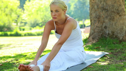 A woman performing a yoga position