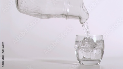 Pouring water in slow motion from a pitcher