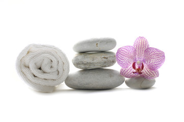 spa stones and towel with pink orchid