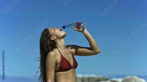 Young woman refreshing in slow motion