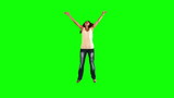 Woman jumping in slow motion while doing a star jump