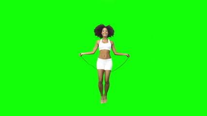 Brunette playing in slow motion with a skipping rope