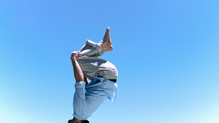Man making a back-flip in slow motion