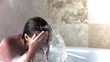 Brunette woman in slow motion taking a bubble bath