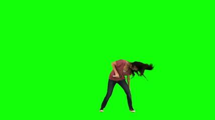 Brunette playing karaoke in slow motion