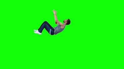 Man in slow motion performing a back-flip