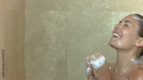Brunette showering in slow motion