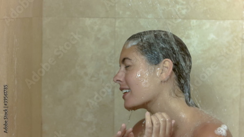 Brunette taking a shower in slow motion