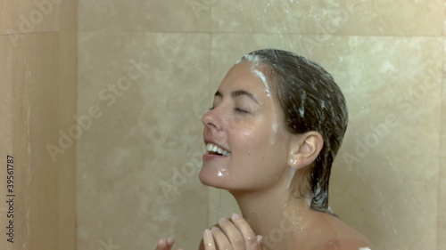 Woman showering in slow motion