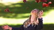 Blonde woman throwing leaves in slow motion