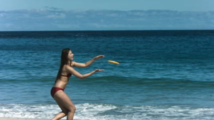 Woman playing frisbee in slow motion
