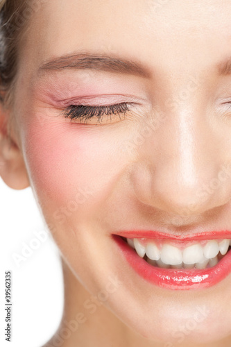 Closeup of beautiful woman laughing