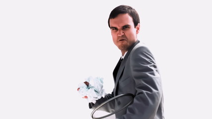 Businessman throwing a paper ball in slow motion