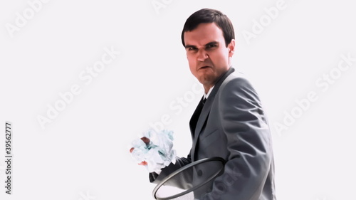 Businessman holding a wastebasket in slow motion