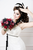 Portrait of beautiful retro bride with wedding bouquet
