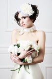 Portrait of beautiful retro bride with wedding bouquet