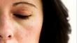 Woman in slow motion opening her eye