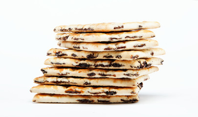 A stack of cookies with caramel filling on a white background.