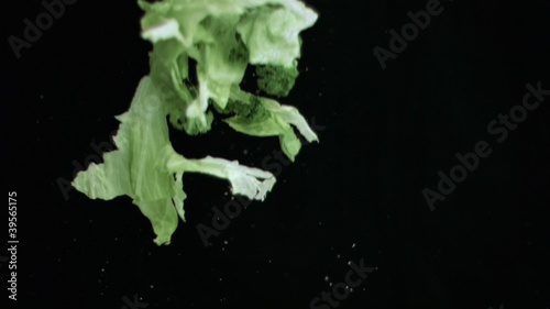 Lettuce thrown upwards in super slow motion