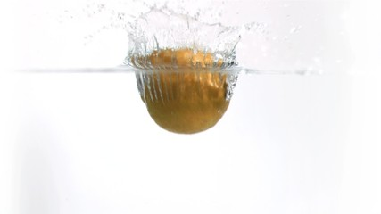 Lemon falling into water in super slow motion