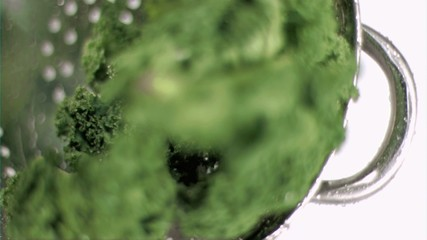 Kale being washed in super slow motion