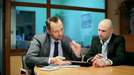 Business partners with digital tablet in the office