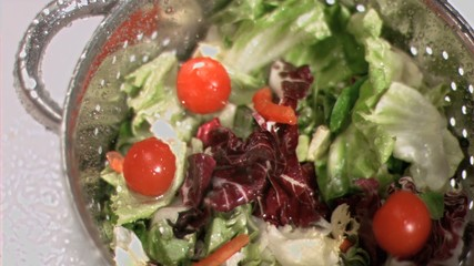 Salad in sieve in super slow motion