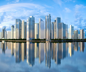 skyscraper skyline reflected on water