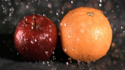 Water raining on fruits in super slow motion