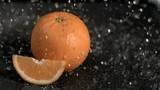 Water raining on oranges in super slow motion