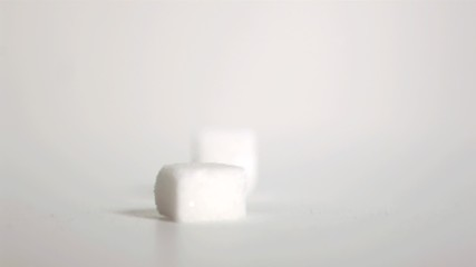 Sugar cubes falling down in super slow motion