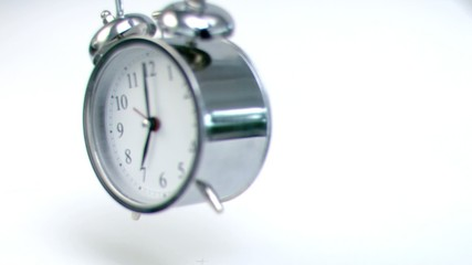 Alarm clock falling down in super slow motion